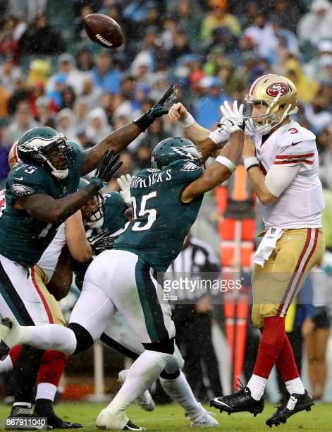 J Beathard of the San Francisco 49ers is pressured by Vinny Curry and Mychal Kendricks of the Philadelphia Eagles in the second half on October 29...