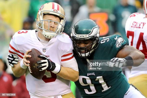 J Beathard of the San Francisco 49ers is sacked by Fletcher Cox of the Philadelphia Eagles in the second quarter during their game at Lincoln...