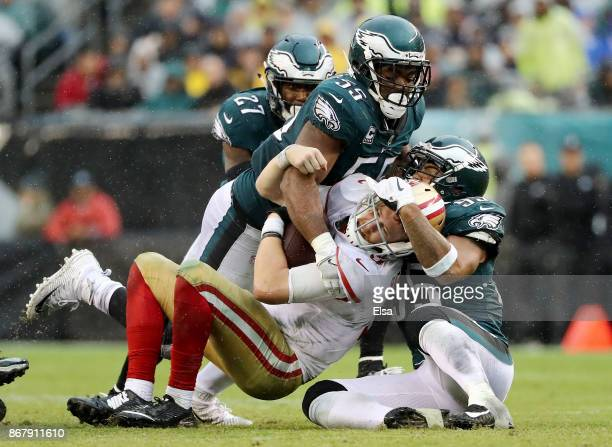 J Beathard of the San Francisco 49ers is sacked by Mychal Kendricks Brandon Graham and Malcolm Jenkins of the Philadelphia Eagles in the second half...