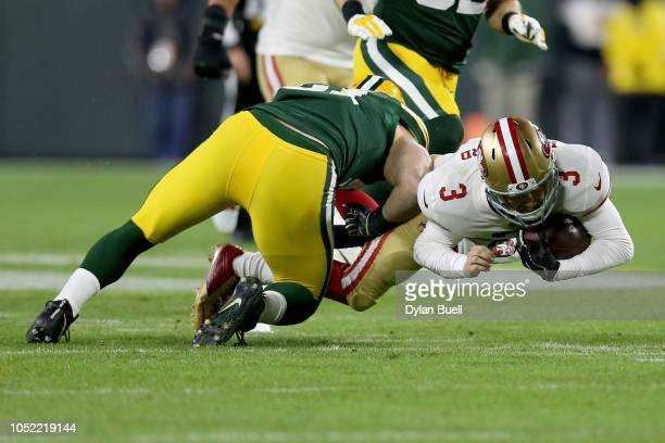 J Beathard of the San Francisco 49ers is stopped by Kyler Fackrell of the Green Bay Packers in the second quarter at Lambeau Field on October 15 2018...