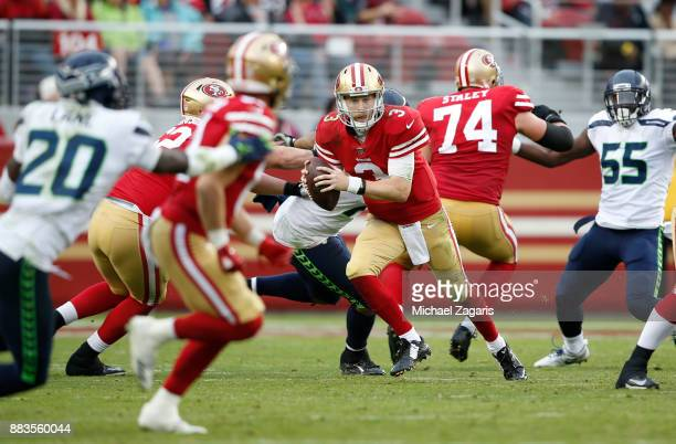 J Beathard of the San Francisco 49ers looks for an open receiver during the game against the Seattle Seahawks at Levi's Stadium on November 26 2017...