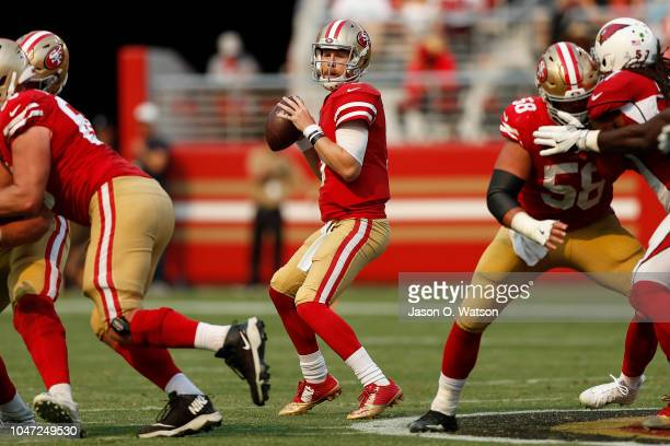 J Beathard of the San Francisco 49ers looks to pass against the Arizona Cardinals during their NFL game at Levi's Stadium on October 7 2018 in Santa...