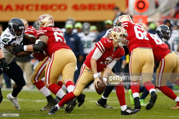 J Beathard of the San Francisco 49ers passes the ball against the Seattle Seahawks at Levi's Stadium on November 26 2017 in Santa Clara California