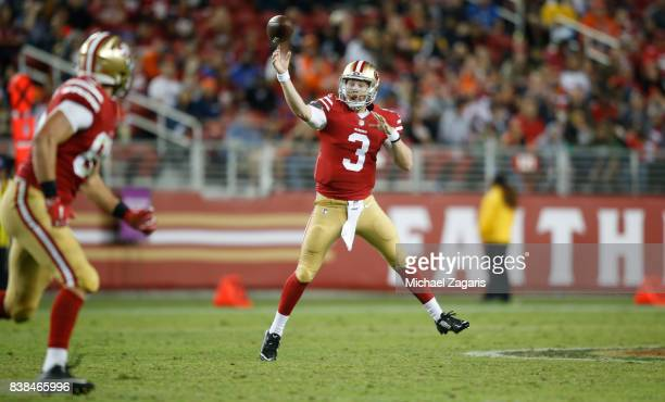 J Beathard of the San Francisco 49ers passes to George Kittle for a touchdown during the game against the Denver Broncos at Levi Stadium on August 19...