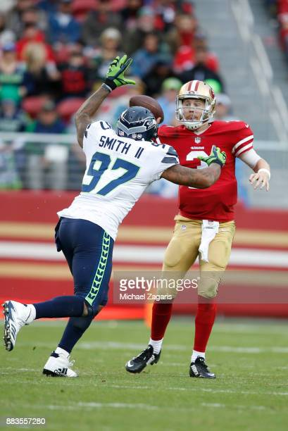 J Beathard of the San Francisco 49ers passes under pressure during the game against the Seattle Seahawks at Levi's Stadium on November 26 2017 in...