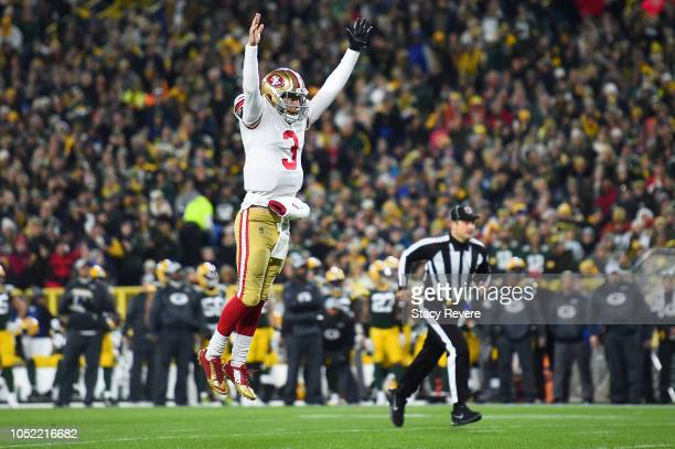 J Beathard of the San Francisco 49ers reacts to a touchdown during the first quarter against the Green Bay Packers at Lambeau Field on October 15...
