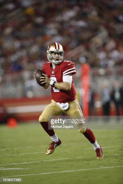 J Beathard of the San Francisco 49ers rolls out during the game against the Dallas Cowboys at Levi Stadium on August 9 2018 in Santa Clara California...