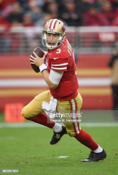 J Beathard of the San Francisco 49ers rolls out to pass against the Seattle Seahawks during their NFL football game at Levi's Stadium on November 26...