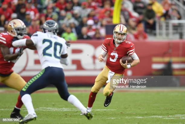 J Beathard of the San Francisco 49ers runs with the ball against the Seattle Seahawks during their NFL football game at Levi's Stadium on November 26...