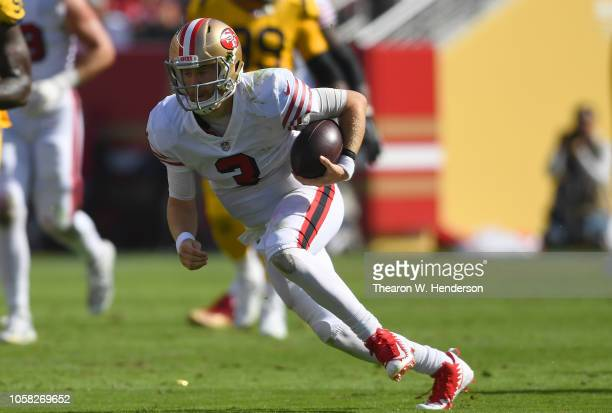 J Beathard of the San Francisco 49ers scrambles with the ball against the Los Angeles Rams during the second quarter of their NFL football game at...