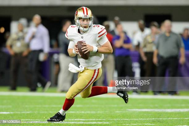 J Beathard of the San Francisco 49ers scrambles with the ball against the Minnesota Vikings in the preseason game on August 27 2017 at US Bank...