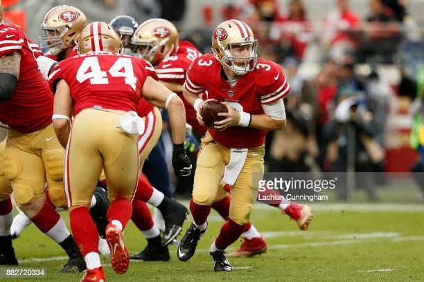 J Beathard of the San Francisco 49ers takes the snap against the Seattle Seahawks at Levi's Stadium on November 26 2017 in Santa Clara California