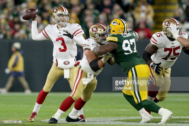 J Beathard of the San Francisco 49ers throws a pass in the second quarter against the Green Bay Packers at Lambeau Field on October 15 2018 in Green...