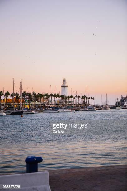 beatiful sunset in the port of malaga - malaga fotografías e imágenes de stock