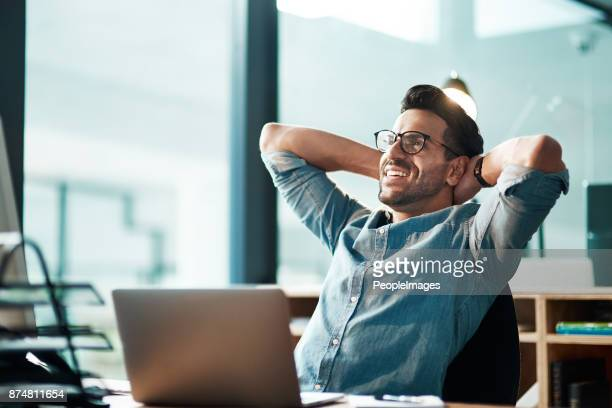 beating the deadline like the champ he is - man in office stock photos and pictures