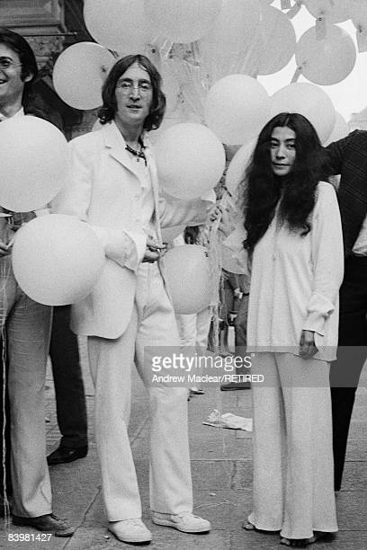 Beatle John Lennon and his girlfriend Yoko Ono outside the Robert Fraser Gallery where Lennon's work is on show at the gallery in an exhibition...