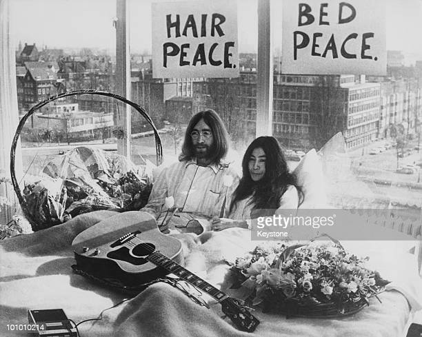 Beatle John Lennon and his wife of a week Yoko Ono in their bed in the Presidential Suite of the Hilton Hotel Amsterdam 25th March 1969 The couple...