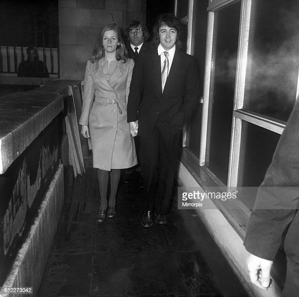 Beatle Paul McCartney and his fiancee Linda Eastman arrives at a side door of the register office at Marylebone March 1969 Z02419011