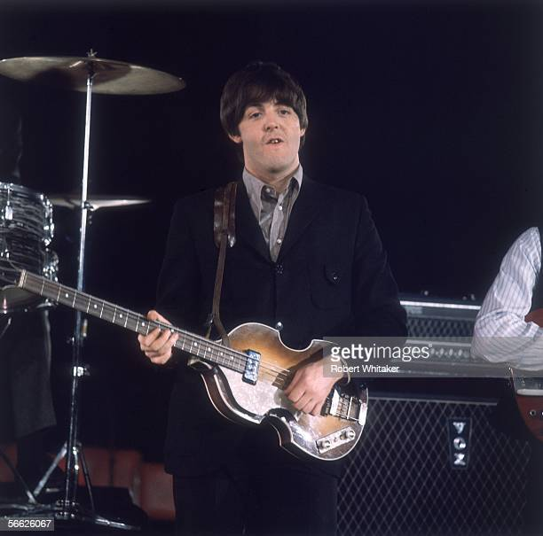 Beatle Paul McCartney, performing during a recording session at Abbey Road Studios where a film of Paperback Writer and Rain was captured for a...