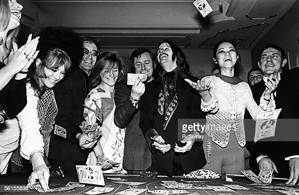 Beatles drummer Ringo Starr enjoying a party thrown by actor and comic Peter Sellers third from left at the Ambassadeurs Club in London 5th May 1969