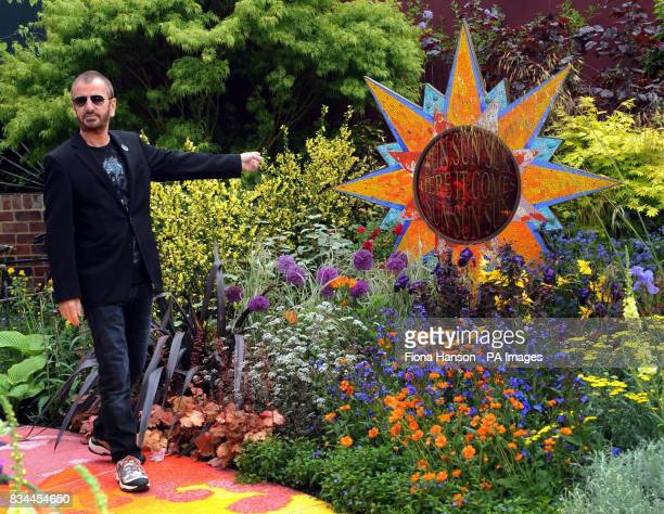 Beatles drummer Ringo Starr in a garden dedicated to George Harrison's memory, 'From Life to Life, A Garden for George' which represents the...