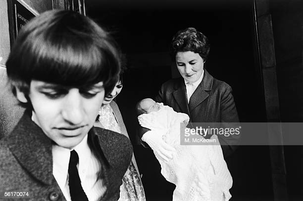 Beatles drummer Ringo Starr leaving Queen Charlotte's Maternity Hospital in Hammersmith with his newborn son, Zak Starkey, 22nd September 1965. Nurse...