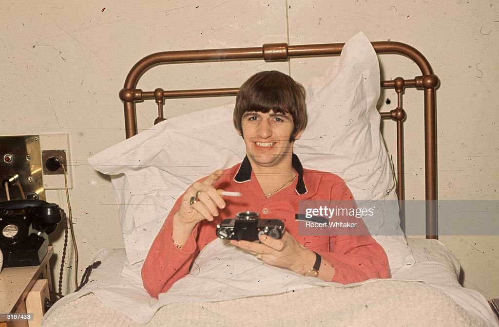 Beatles drummer Ringo Starr pictured in a hospital bed, using a camera body as an ashtray. Starr was having his tonsils removed at University College Hospital, London.