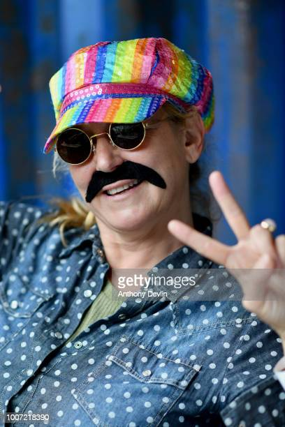 Beatles fan in costume poses for portrait during an attempt to break the Guinness World Record for the largest gathering of Beatles impersonators as...