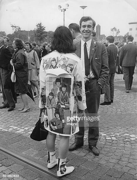 Beatles fan in front of the Grugahalle in Essen. The second Gig of the Beatles in Germany. 25 June 1966 photograph. .