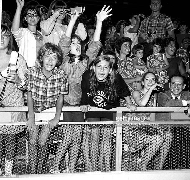 Beatles fans at Shea Stadium register varying emotions during last night's moptop concert.