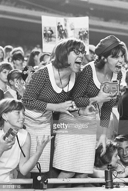 Beatles fans scream at the top of their lungs during a concert at Shea Stadium.