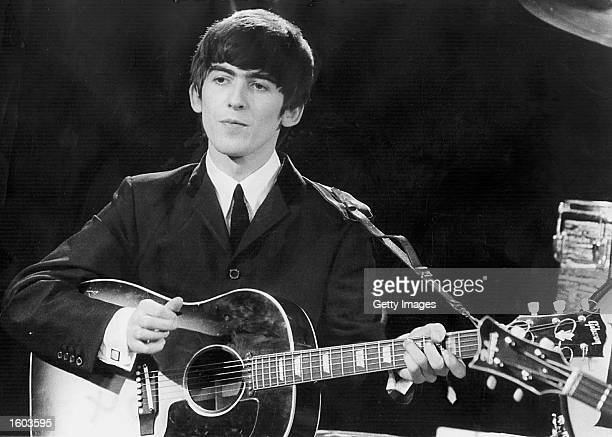 Beatles guitarist and singer George Harrison performs December 3 1963 during a concert Conflicting reports were released July 23 2001 regarding the...