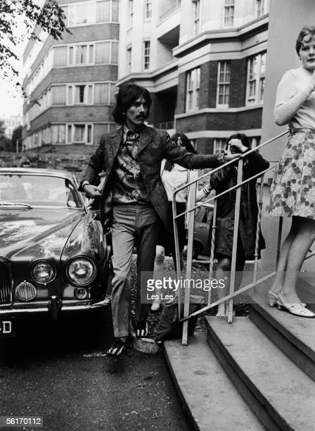 Beatles guitarist George Harrison arriving for rehearsals at the EMI studios in Abbey Road London 22nd June 1967