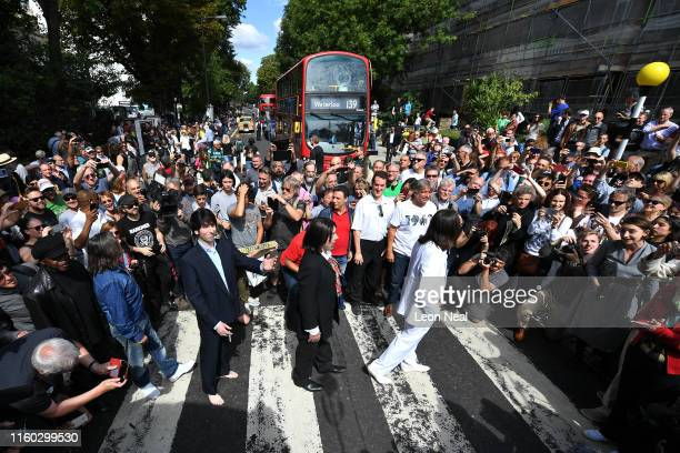 Beatles impersonators recreate the iconic 'Abbey Road' photograph made 50 years ago today on August 8 2019 in London England 50 years ago today John...