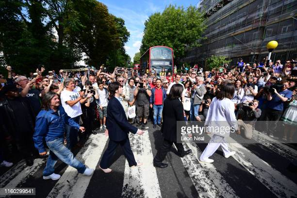 Beatles impersonators recreate the iconic 'Abbey Road' photograph made 50 years ago today, on August 8, 2019 in London, England. 50 years ago today,...