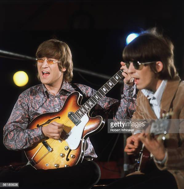 Beatles John Lennon and George Harrison during the Abbey Road session to record Paperback Writer and Rain April 1966