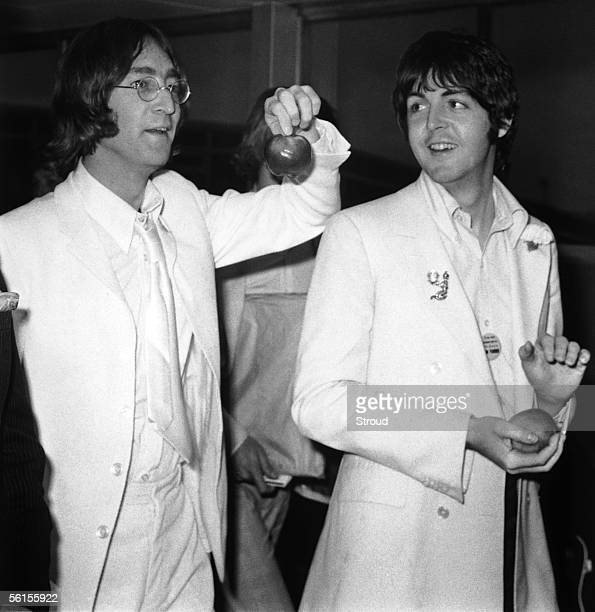 Beatles John Lennon and Paul McCartney at London Airport after a trip to America to promote their new company Apple Corps, 16th May 1968. They are...