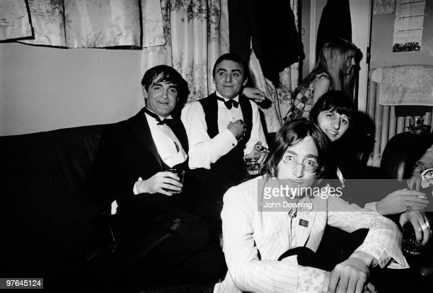 Beatles John Lennon and Ringo Starr visit singer Gerry Marsden backstage at the Adelphi Theatre in London after Marsden's first night in the West End...
