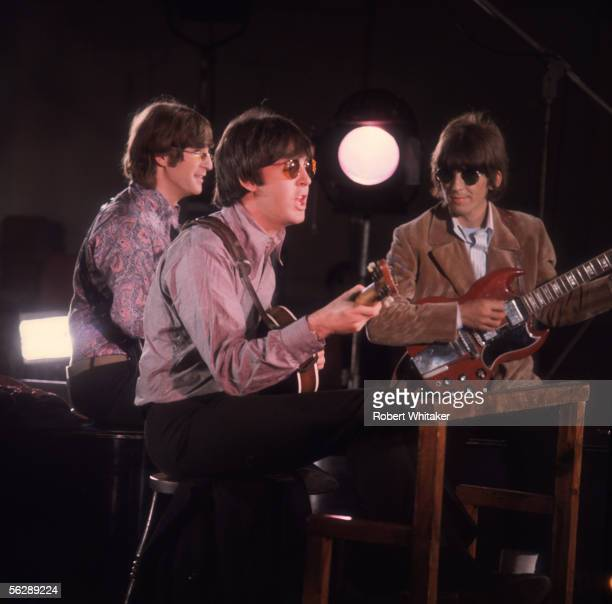 Beatles John Lennon George Harrison and Paul McCartney playing their guitars during the Abbey Road session to record Paperback Writer and Rain April...
