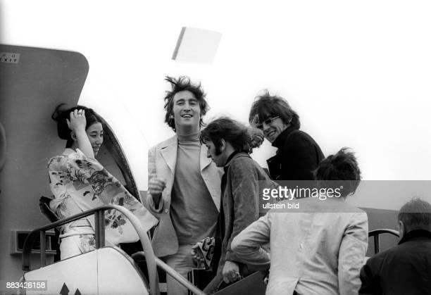 Beatles leaving Hamburg on the gangway of a Japan Airlines aircrat at Hamburg airport from left John Lennon Ringo Starr George Harrison Paul McCartney