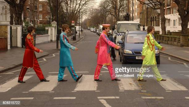 Beatles lookalikes cross the famous zebra crossing in Abbey Road St John's Wood London Tuesday January 31 2006 The lyrics of The Beatles' 'A Day in...