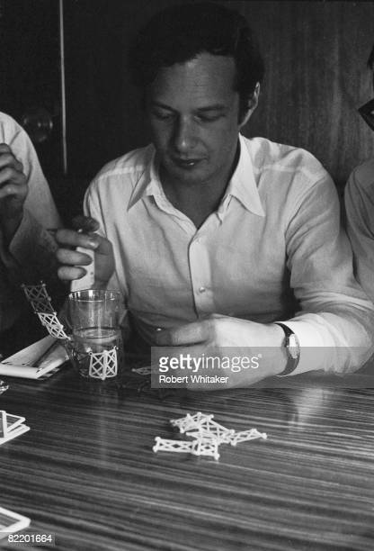 Beatles manager Brian Epstein plays a game of cards during the Philippines leg of the Beatles' final world tour 3rd5th July 1966
