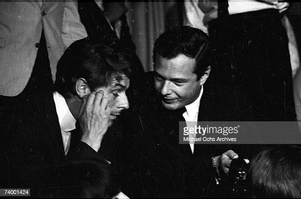 Beatles Press agent Derek Taylor and manager Brian Epstein at a press conference held at the at the Cinnamon Cinder club before the Beatles'...
