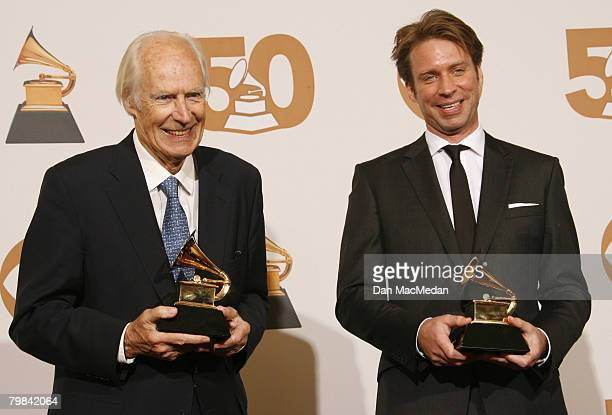 Beatles producer Sir George Martin and producer Giles Martin pose in the press room with the award for Best Compilation Soundtrack Album for Love...
