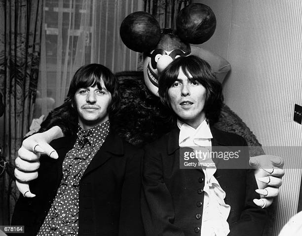 Beatles Ringo Starr and George Harrison pose with a Blue Meanie a character from their animated musical film Yellow Submarine July 8 1968 in London...