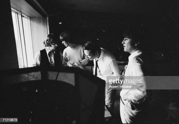 Beatles Ringo Starr George Harrison and John Lennon in a hotel room with their manager Brian Epstein during the band's 1966 Asisan tour