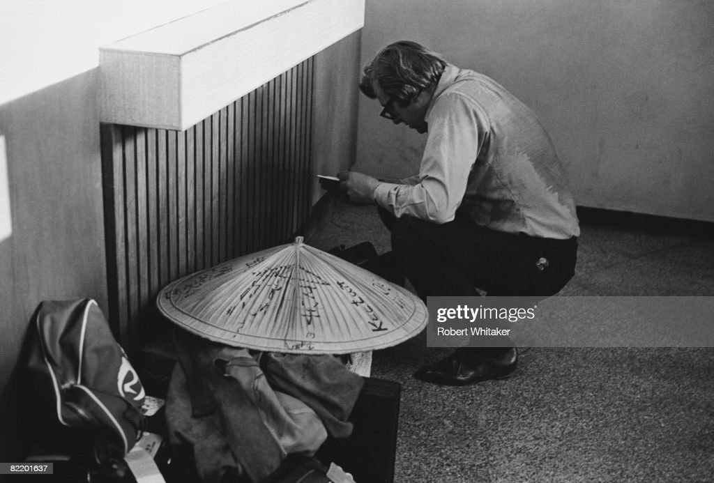 Beatles road manager Mal Evans (1935 - 1976) packs the group's souvenirs at Manila International Airport in the Philippines, during the group's final world tour, 5th July 1966. The group made a hasty exit from the country after a perceived snub on President Ferdinand Marcos and his wife Imelda resulted in official hostility, including the withdrawal of police protection for the group.