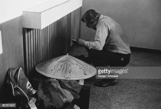 Beatles road manager Mal Evans packs the group's souvenirs at Manila International Airport in the Philippines during the group's final world tour 5th...