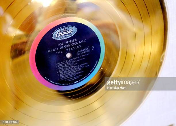 Beatles 'Sgt Pepper's Lonely Hearts Club Band' original RIAA white matte gold LP record album award presented to The Beatles for auction at Gotta...