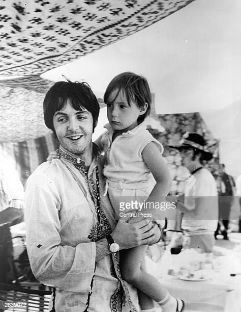 Beatles singer and bass player Paul McCartney holds four year old Julian son of his colleague John Lennon during a holiday near Athens in Greece
